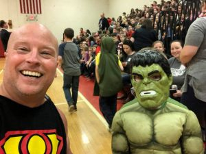 stonehands posing with student dressed as hulk